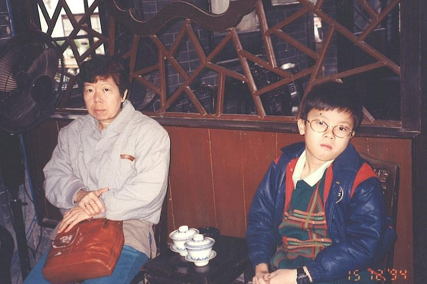 """A young Jason Chee with his mother, Madam Chua Ah Lek, during a holiday in Macau in 1994. Madam Chua, who died in 2011, taught her son """"to be determined and to not give up on things""""."""