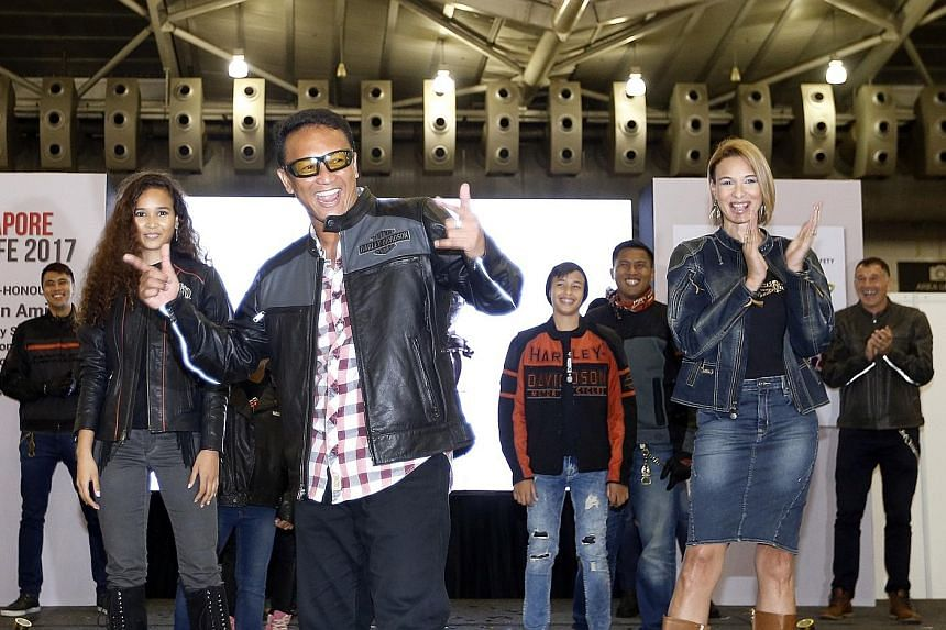 Modelling riding jackets to promote protective gear for safe riding are (from left) Iman Fandi, her dad Fandi Ahmad, Fandi's son Ilhan, Noh Alam Shah and Fandi's wife Wendy Jacobs.