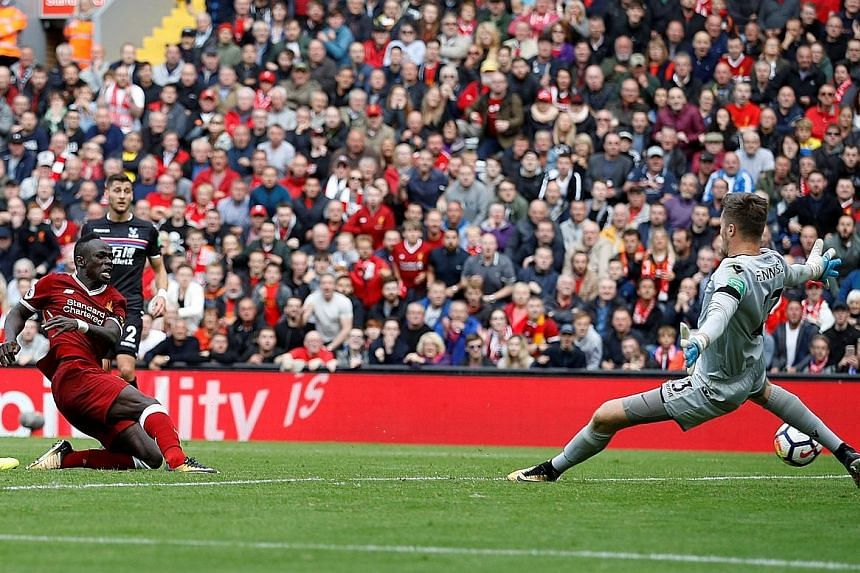 Sadio Mane (in red) scoring an opportunistic goal to give Liverpool a 1-0 win over Crystal Palace at Anfield yesterday. Reds manager Jurgen Klopp gave special praise to Mane.