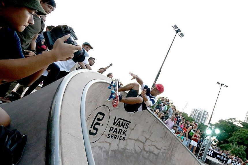 Japanese teenager Kensuke Sasaoka entertaining about 100 fans as he wins the men's category in the Vans Park Series Asian Continental skateboarding championships.