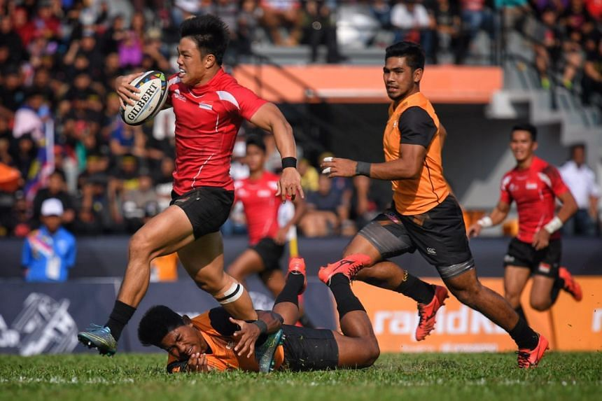 Nicholas Yau of Singapore breaks away from the pack during the SEA Games rugby final against Malaysia, on Aug 20, 2017.