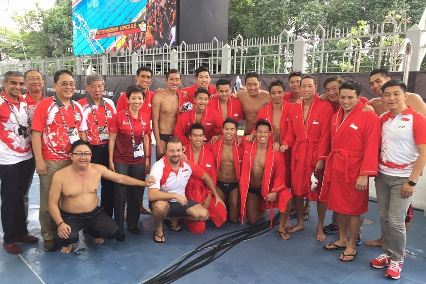 Singapore's water polo men with Grace Fu (fifth from left) and Tan Chuan-Jin (right) on Aug 20, 2017.