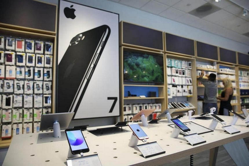 Apple Inc iPhones and iPads for sale at an AT&T Inc store in Newport Beach, on Aug 10, 2017.