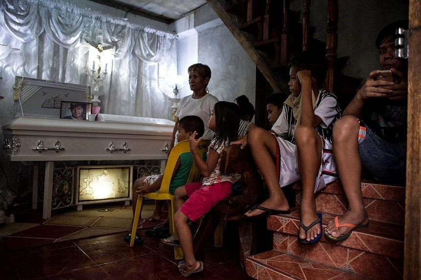 Relatives attending the wake of alleged drug dealer killed by an unidentified gunman in Manila on May 3, 2017.