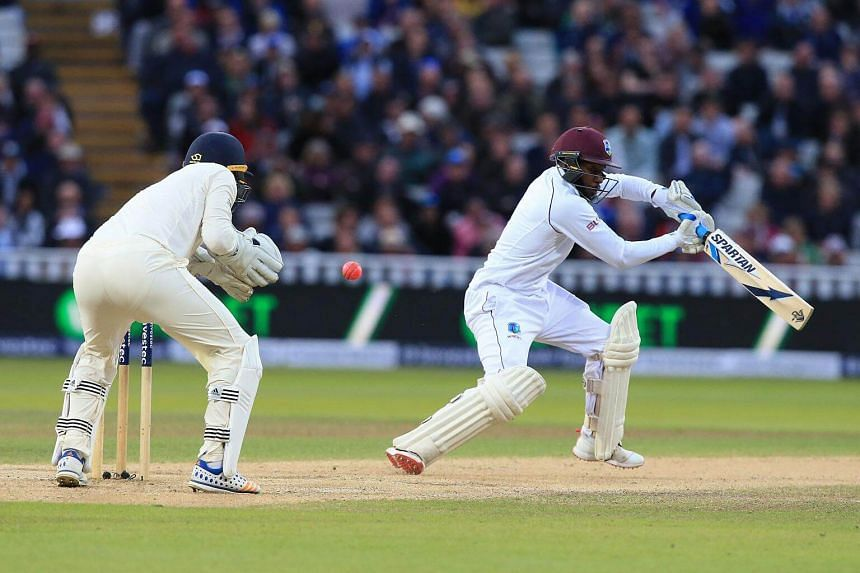 West Indies' Jermaine Blackwood (right) misses the ball on day 3 of the first Test cricket match between England and the West Indies at Edgbaston in Birmingham, on Aug 19, 2017.