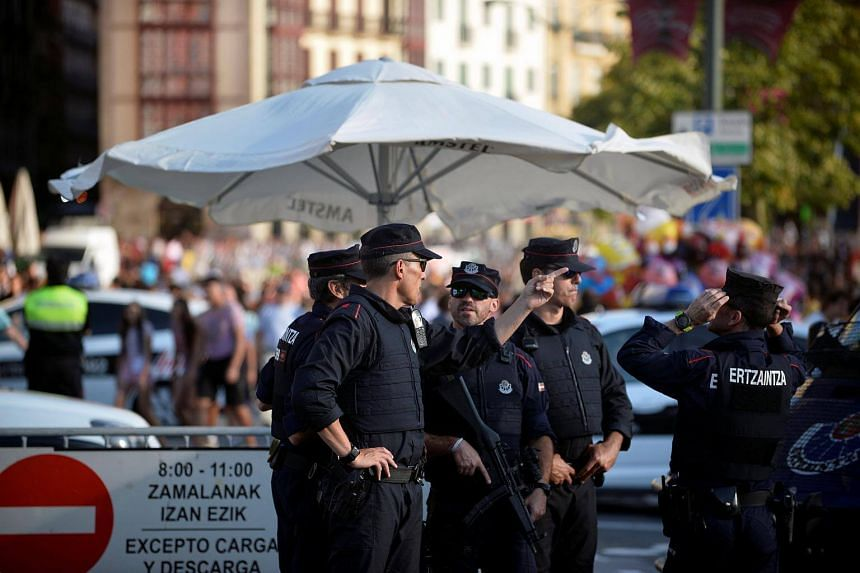 Police officers stand at a road block at the beginning of fiestas in Bilbao, on Aug 19, 2017.