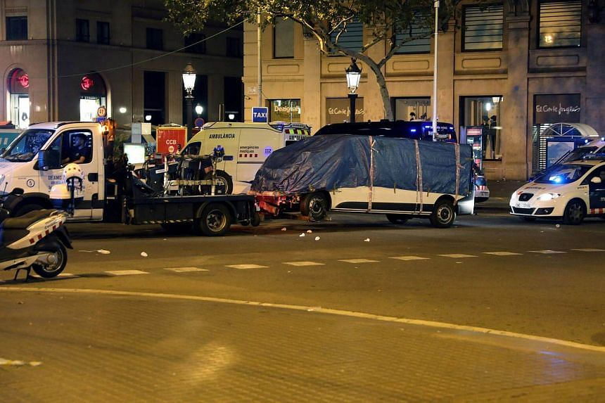 The suspected van is towed away from the area where it crashed into pedestrians at Las Ramblas in Barcelona, Spain, on Aug 18, 2017.
