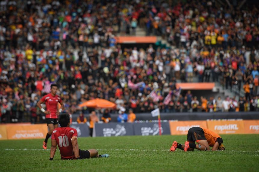 Singaporean and Malaysian players react after the SEA Games rugby final, on Aug 20, 2017.