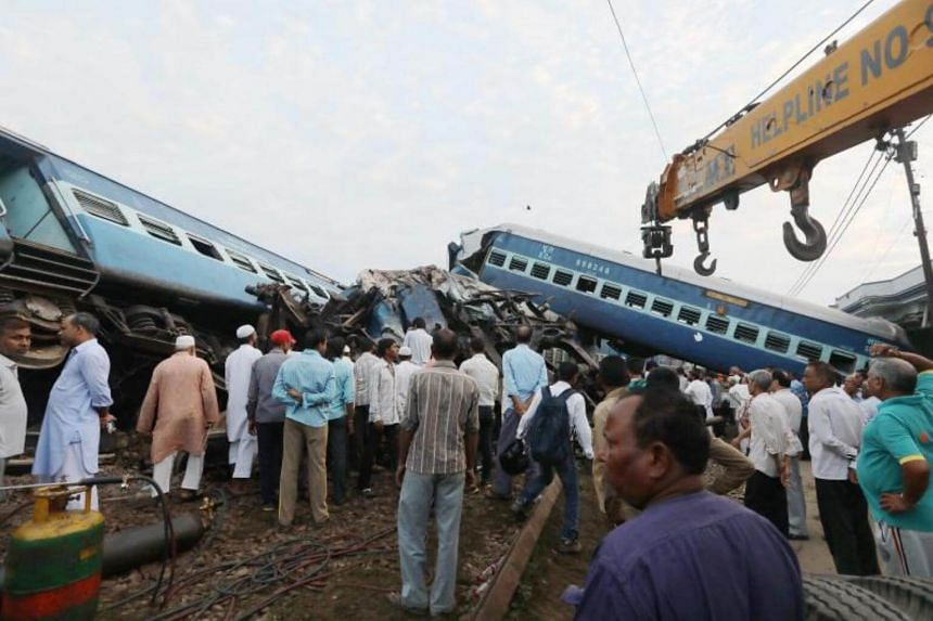 Rescue work continues at the site of a train accident where coaches of Puri-Haridwar Kalinga Utkal Expresss train derailed in Khatauli near Muzaffarnagar, India, on Aug 20, 2017.