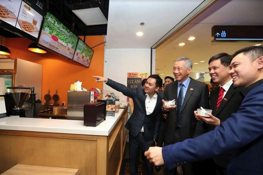 PM Lee Hsien Loong visiting the Xiao Ban store in Ho Chi Minh City on March 22, 2017.