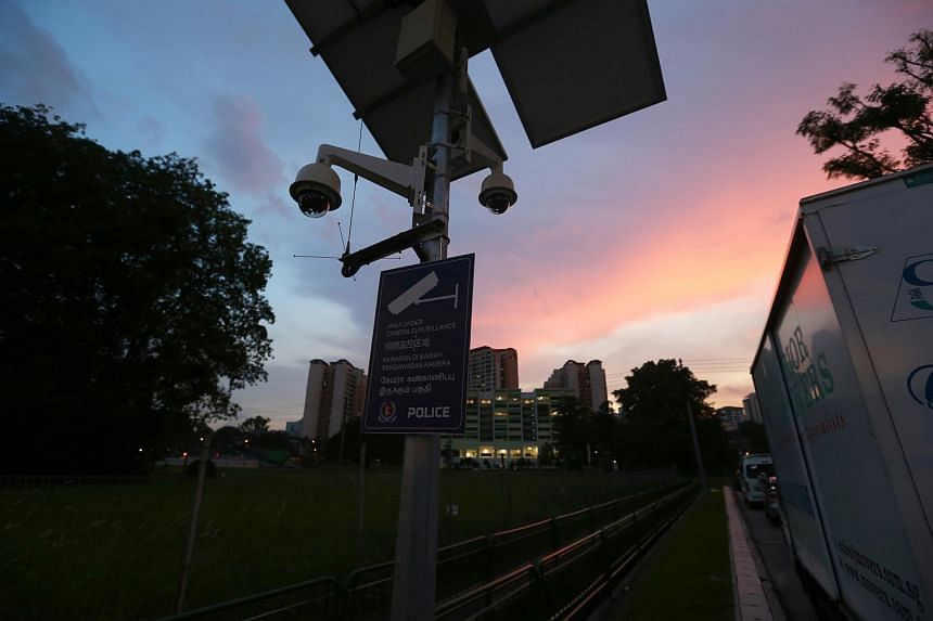 Police security cameras monitoring traffic at the entrance of Yew Tee Industrial Estate.