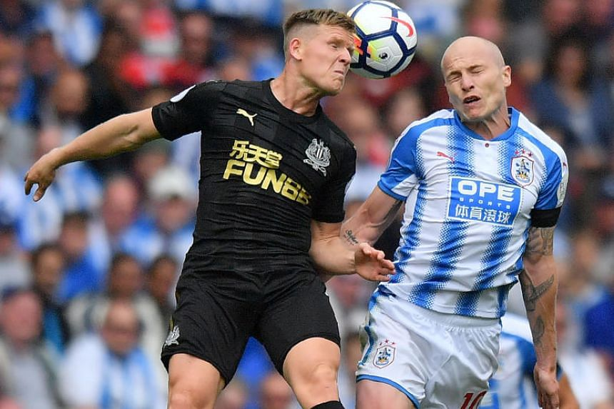 Huddersfield Town's Australian midfielder Aaron Mooy (right) vies for the ball in the match against Newcastle United on Aug 20, 2017.