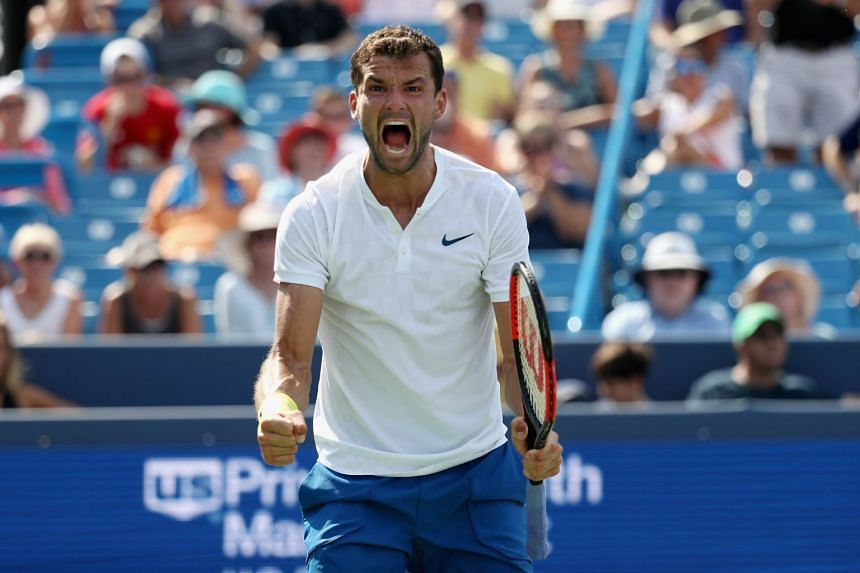 Grigor Dimitrov of Bulgaria celebrates after defeating John Isner.