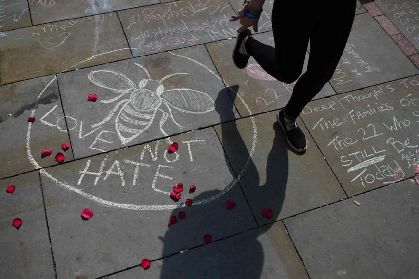 """A message in chalk reading """"Love not Hate"""" in St Ann's Square in Manchester, north-west England, on May 25, 2017, placed in tribute to the victims of the May 22 terror attack at the Manchester Arena."""