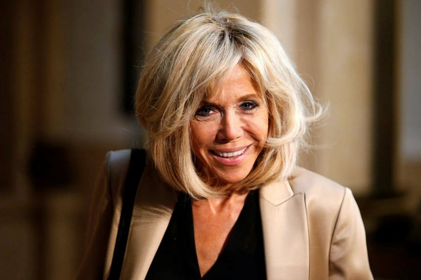 French President's wife Brigitte Macron arriving to attend the partners' programme at the city hall during the G20 summit in Hamburg, northern Germany on July 08, 2017.