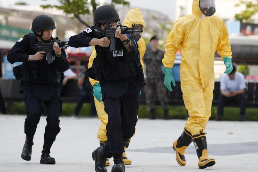 South Korean combat policemen take part in an anti-terrorism drill during the South Korean and US military forces joint Ulchi Freedom Guardian (UFG) exercises at the Korea International Exhibition Center (KINTEX) in Goyang, South Korea, on Aug 21, 20