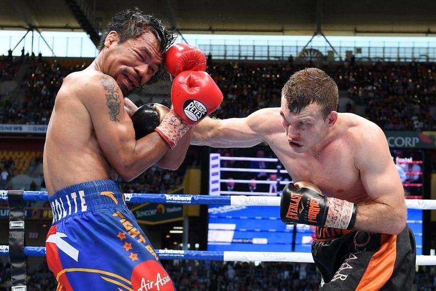 Jeff Horn of Australia punches Manny Pacquiao of the Philippines during the WBO World Welterweight Title in Brisbane, Australia, on July 2, 2017.