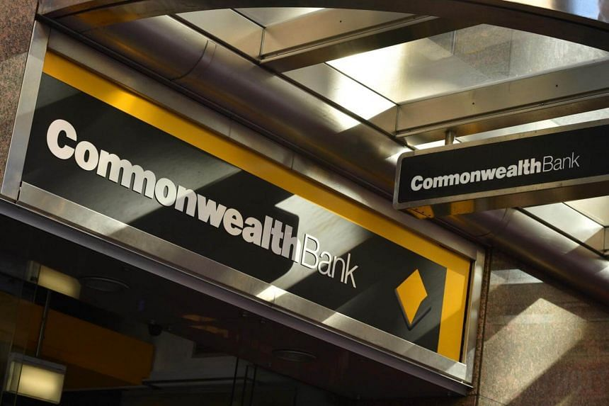 Signs for the Commonwealth Bank are seen outside a branch in Sydney.