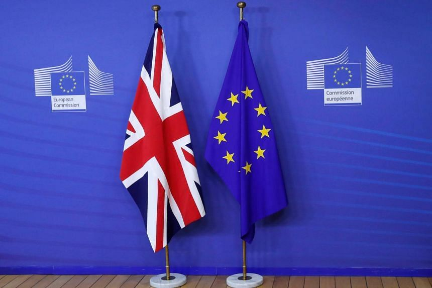 The flags of Britain and the EU are seen at the EU Commission headquarters in Brussels, ahead of Brexit talks on July 17, 2017.