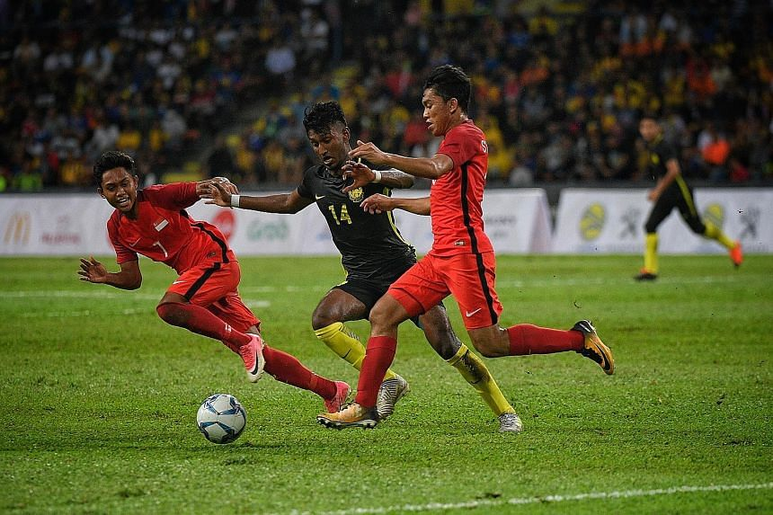 The Young Lions, in red, may have lost the SEA Games match (above) to Malaysia last Wednesday but the players had put in a creditable performance, especially in the first half, said the writer.