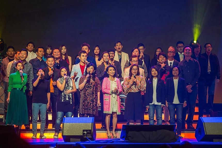 A group performance (above) at the Xinyao 35 Reunion Concert at The Star Theatre last Saturday; veteran songwriter Ng King Kang and singer-songwriter Roy Loi at the concert.