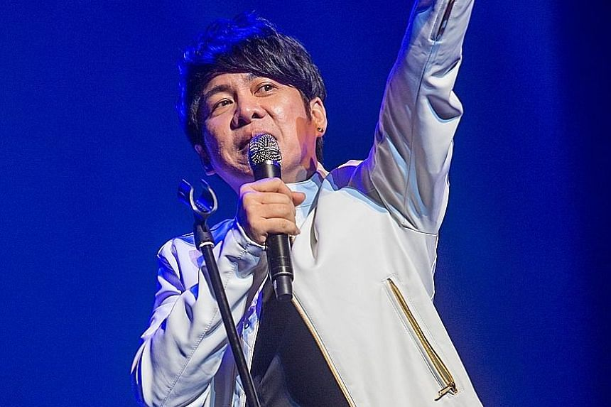 A group performance at the Xinyao 35 Reunion Concert at The Star Theatre last Saturday; veteran songwriter Ng King Kang and singer-songwriter Roy Loi (above) at the concert.