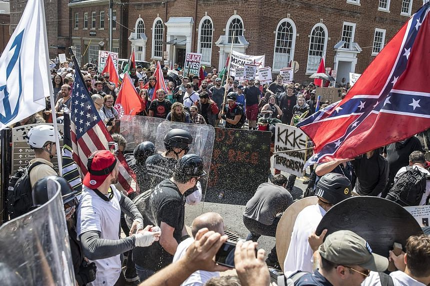 White nationalists clashing with counter-protesters in Charlottesville, Virginia, on Aug 12. US President Donald Trump's comments about the deadly violence have sent the White House into further disarray and prompted corporate leaders to resign from