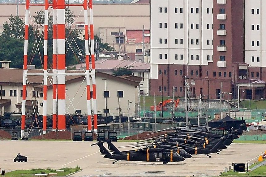 Helicopters at Camp Humphreys in Pyeongtaek, South Korea, yesterday ahead of the Ulchi Freedom Guardian exercise which starts today and will run until Aug 31.