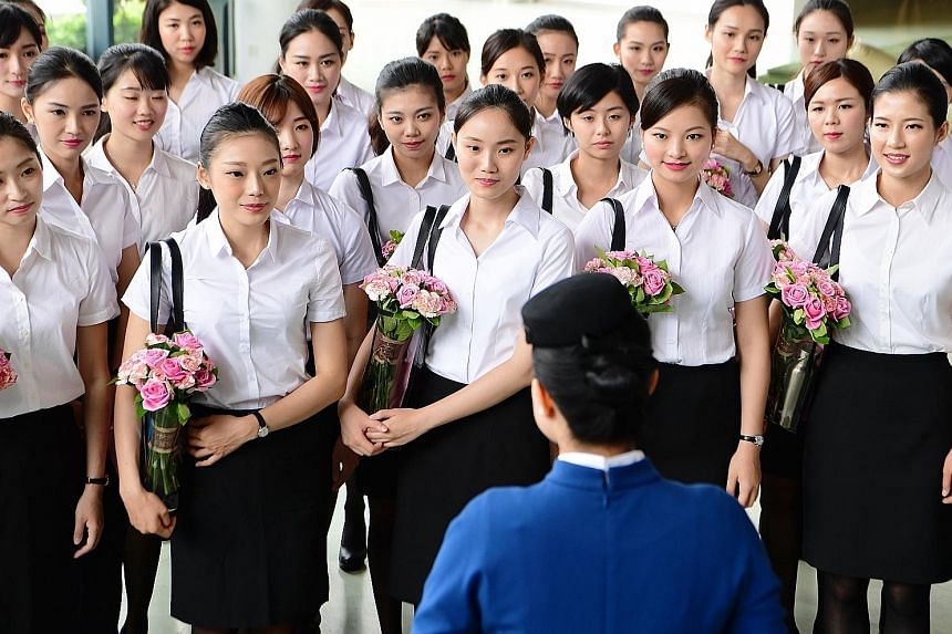 """China's XiamenAir unveiling its first batch of Taiwanese cabin crew last Wednesday. China is wooing youth from the island in what analysts say is a """"soft power"""" push to sway political sentiment."""