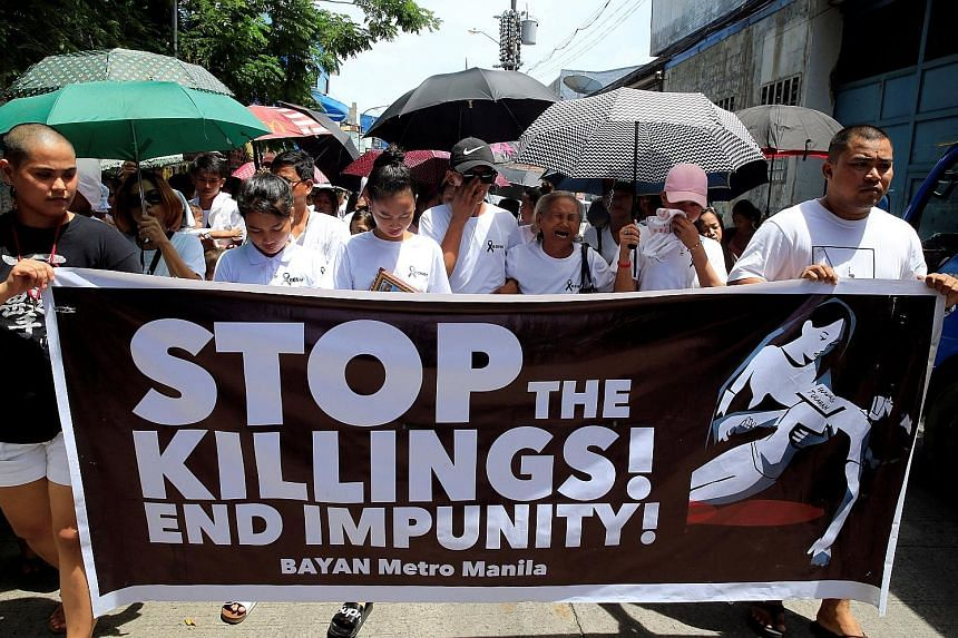 Relatives and loved ones of drug-war victim Leover Miranda, 39, calling for a stop to President Rodrigo Duterte's ruthless campaign during a funeral march in metro Manila yesterday.