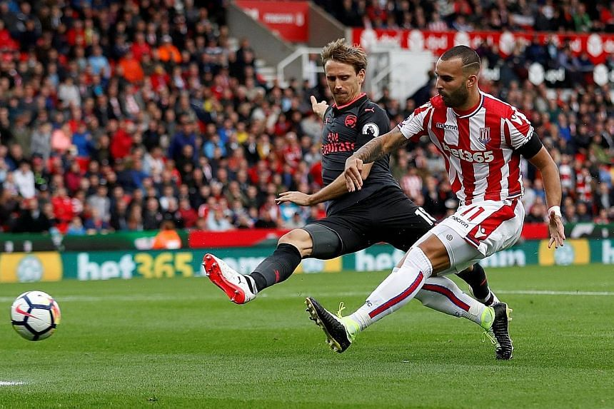 Stoke's Jese Rodriguez slotting home the 47th-minute winner after a rapid counter-attack. Arsenal next play Liverpool at Anfield on Sunday with question marks over their rearguard.