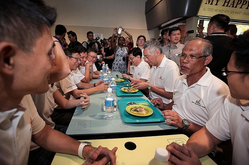 Prime Minister Lee Hsien Loong eating soto ayam with ministers Heng Swee Keat and Masagos Zulkifli at a community event in Tampines earlier this month. With them are minister Chan Chun Sing and other MPs. PM Lee urged Singaporeans to opt for healthie