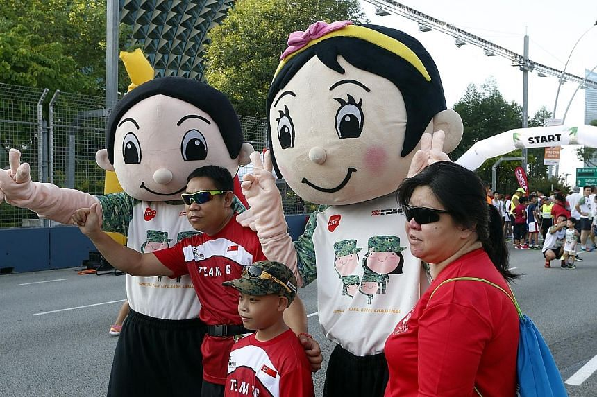 The Families for Life 800m Challenge (above) saw parents and children running together. Participants at yesterday's Safra Singapore Bay Run and Army Half Marathon also got to interact with the event mascots.
