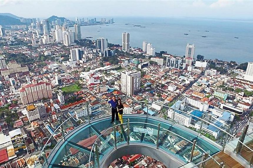 The Rainbow SkyWalk at Komtar mall in George Town, with a breathtaking view of the Penang coastline. The heady pace of development in the state, spurred further by George Town's listing as a Unesco World Heritage Site, has sent property prices and li
