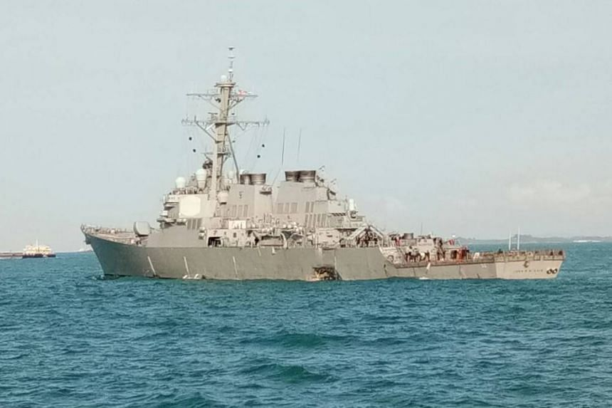 Photo released by the Malaysian navy showing the damaged USS John S. McCain after the collision.