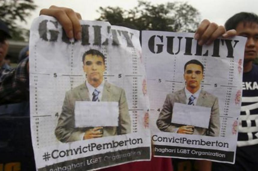 Activists display images of US Marine Lance Corporal Joseph Scott Pemberton during a rally for Laude outside the US embassy in Manila, Philippines, on Dec 1, 2015.