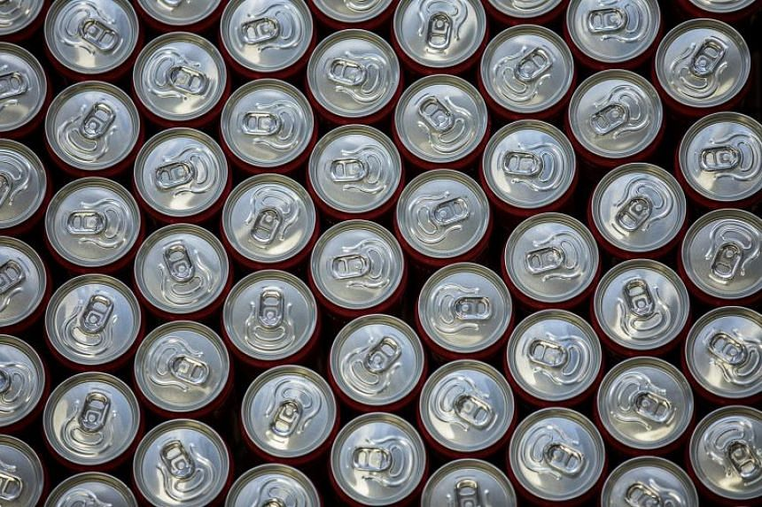 Cans of soft drink are seen at a factory.