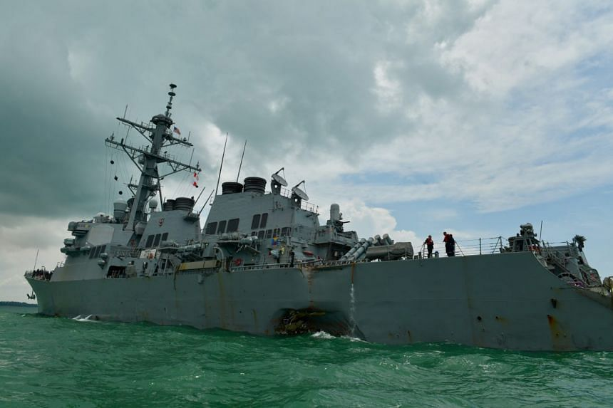 The USS John S. McCain, a guided-missile destroyer, arrived near the Changi Naval Base at 1.30pm after colliding with the Alnic MC in the early hours of Aug 21, 2017.