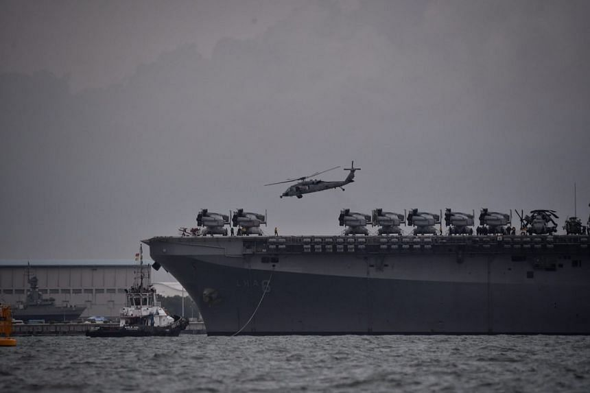 Helicopters leaving an aircraft carrier in pairs and heading southwards to continue the search and rescue efforts.