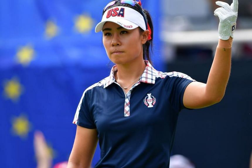 Danielle Kang of Team USA gestures during the final day singles matches of The Solheim Cup.