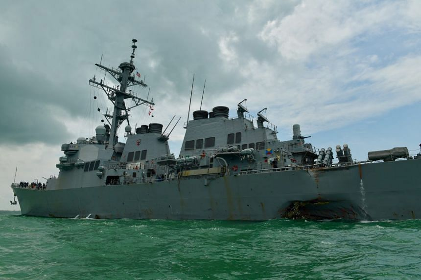 US guided-missile destroyer USS John McCain arriving near the Changi Naval Base at about 1.30pm after a collision on Aug 21, 2017.