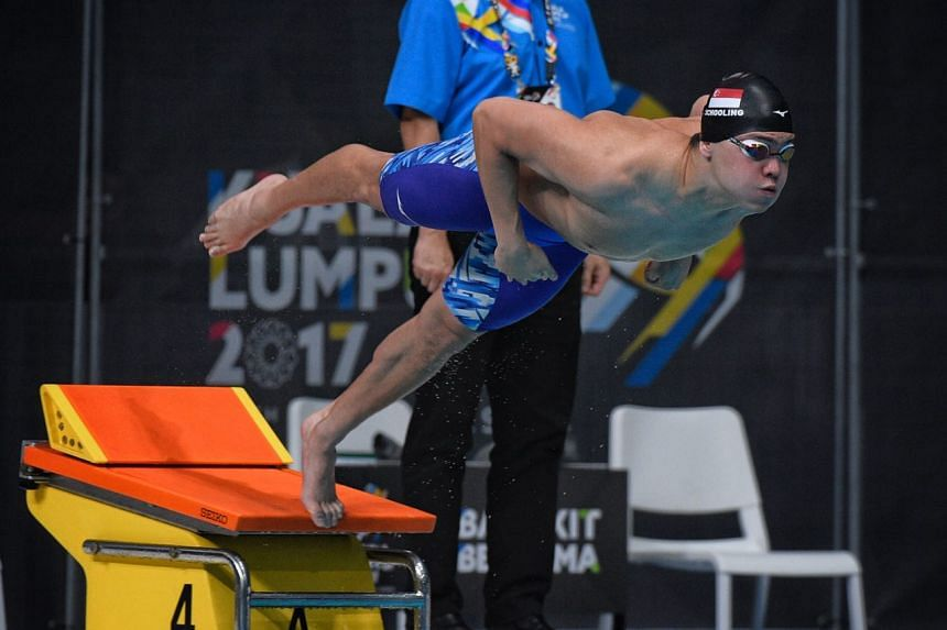 Singapore's Joseph Schooling leaping from the starting blocks during the men's 50m butterfly final at the SEA Games on Aug 21, 2017.