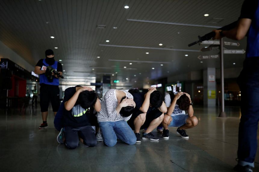 People taking part in an anti-terror drill as a part of the Ulchi Freedom Guardian exercise in Goyang, South Korea , on Aug 21, 2017.