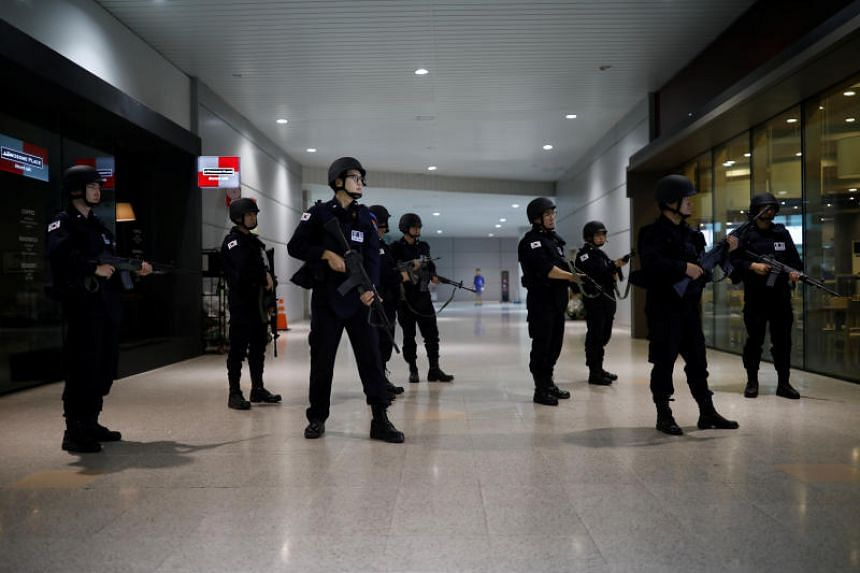 South Korean policemen taking part in an anti-terror drill as a part of the Ulchi Freedom Guardian exercise in Goyang, South Korea, on  Aug 21, 2017