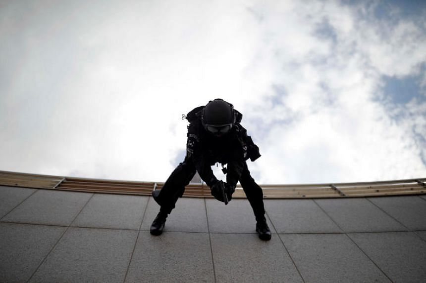 A member of Special Weapon and Tactics (SWAT) rappelling down during an anti-terror drill as a part of the Ulchi Freedom Guardian exercise in Goyang, South Korea, on Aug 21, 2017.