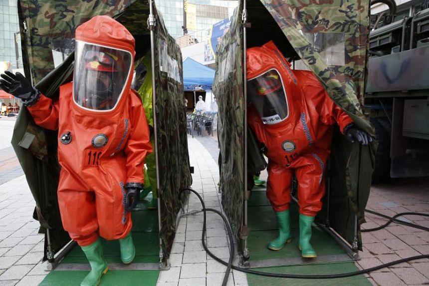 South Korean fire fighters taking part in an anti-terrorism drill during the South Korean and US military forces joint Ulchi Freedom Guardian (UFG) exercises at the Korea International Exhibition Center (KINTEX) in Goyang, north of Seoul, South Korea