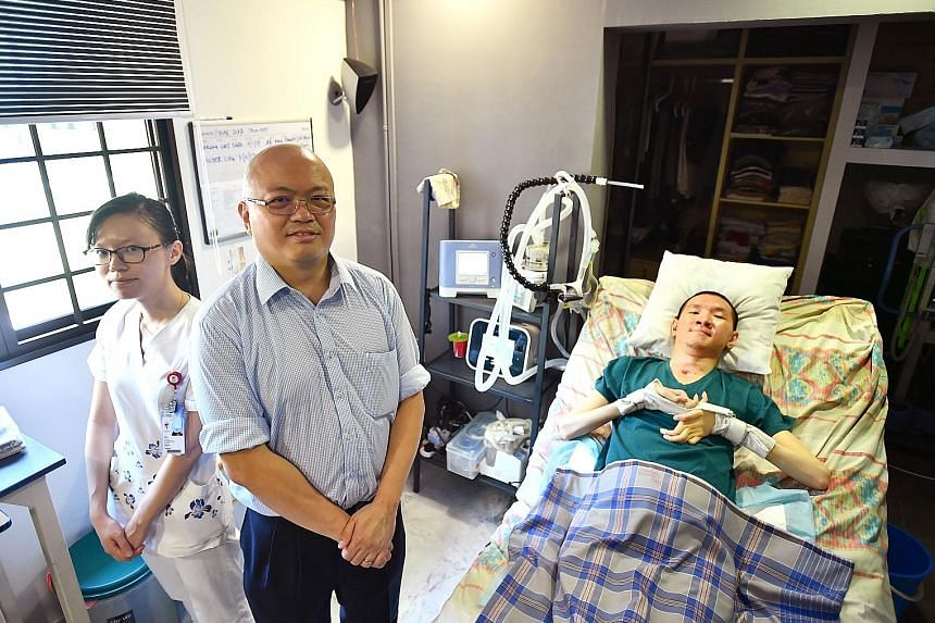 Dr Chan Yeow, director of TTSH's Home Ventilation and Respiratory Support Service, and senior staff nurse Ni Bin with patient Jason Ong, who suffered a spinal cord injury 14 years ago. The portable ventilator in Mr Ong's bedroom at his home in Telok