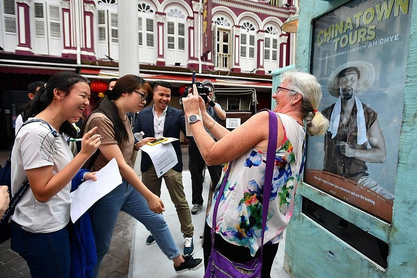 An Australian tourist taking a selfie in April with a character in the digital screen, part of a pilot initiative by STB to promote Chinatown. More than a million Australians visited Singapore last year.