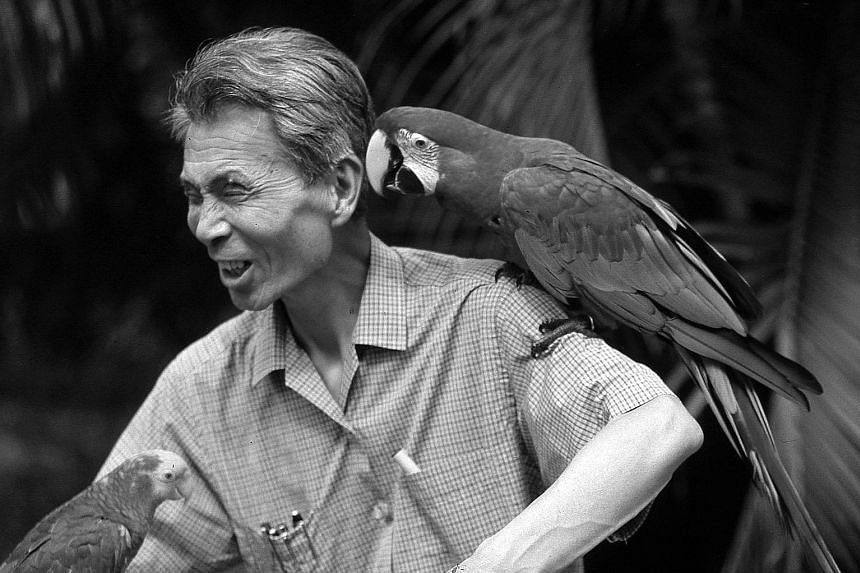 Artist Wu Guanzhong is surrounded by parrots at Jurong Bird Park, where he painted his 1998 work Parrot Haven.