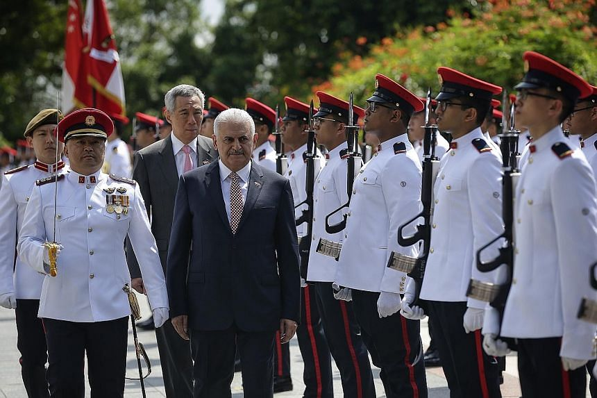Singapore Prime Minister Lee Hsien Loong and Turkish Prime Minister Binali Yildirim at the official welcome ceremony at the Istana yesterday.